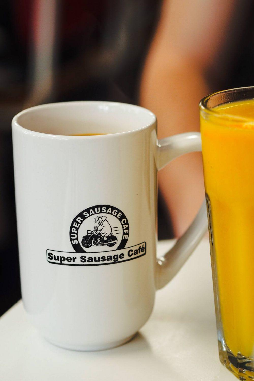 A Mug with The Super Sausage logo on