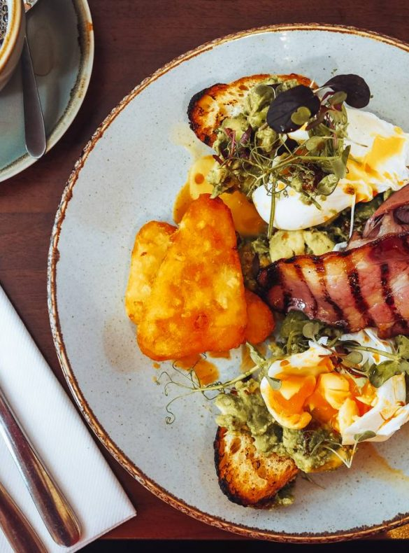 Avocado, poached eggs and bacon on toast at The Greedy Italian