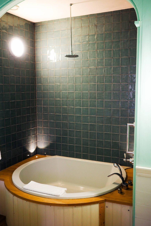 The huge bathtub in the bathroom of the Nightingale Suite
