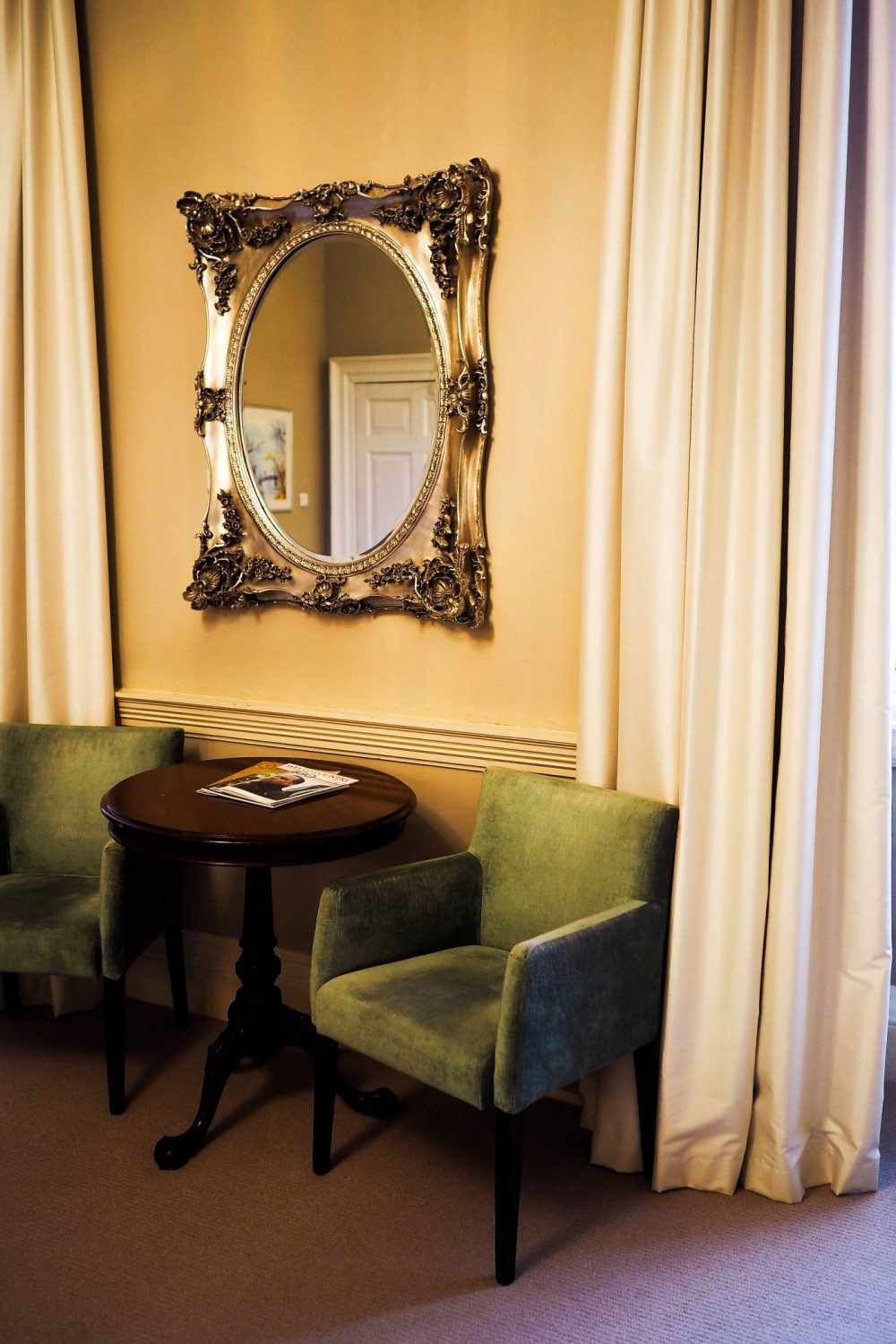 Two chairs and a table in the Nightingale suite at Nanteos Mansion