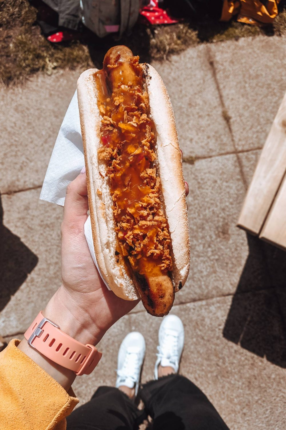 Jamaican Jerk hot dog topped with sauce and crispy onions by SIzzlers Street Food Milton Keynes