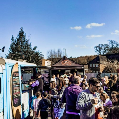 A crowd of people and street food vans at Nonna's Street Food Festival