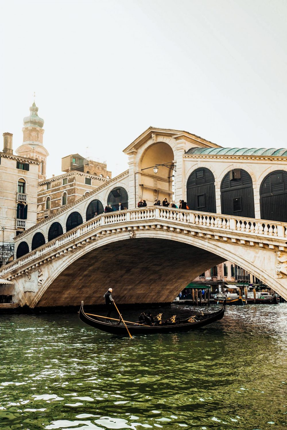 The Rialto Bridge and Gondolier in Venice