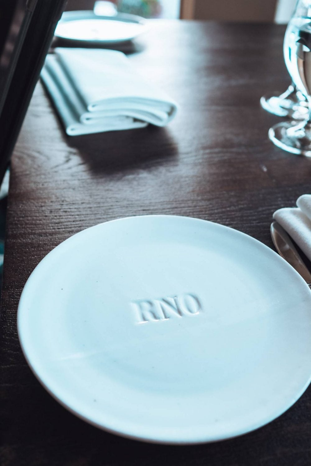White plate with 'RNO' engraved
