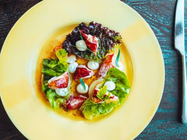 Port Isaac Lobster Salad on a yellow plate