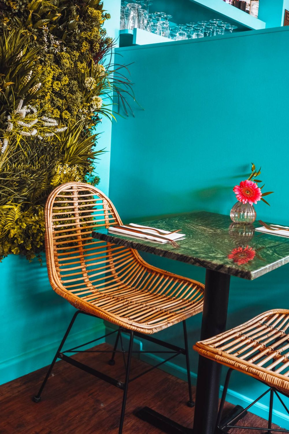 Chair against green wall in Greek affaire