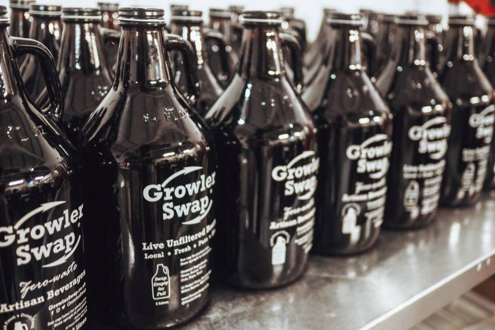 A line of Bucks Star Beer growlers