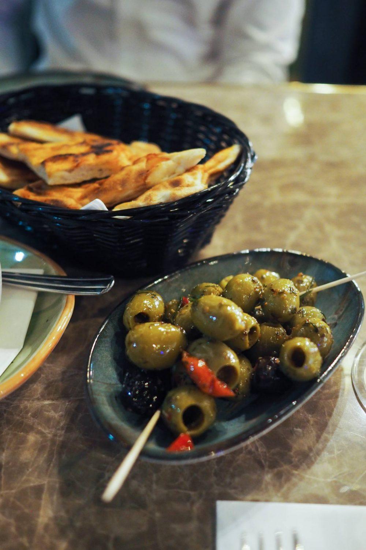 Olives and pitta at deroka restaurant