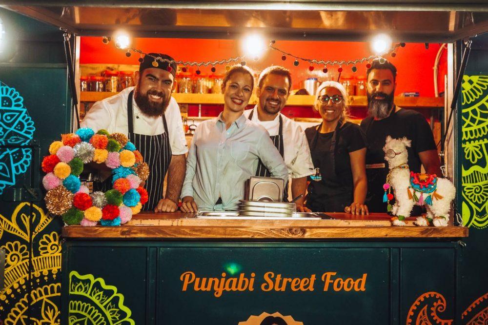 A photo of Daniel Roberts, Beatriz De Juan, Juan Carlos, Safia Ali and Ishraz in Saf's Kitchen's van outside Olé Tapas Bar
