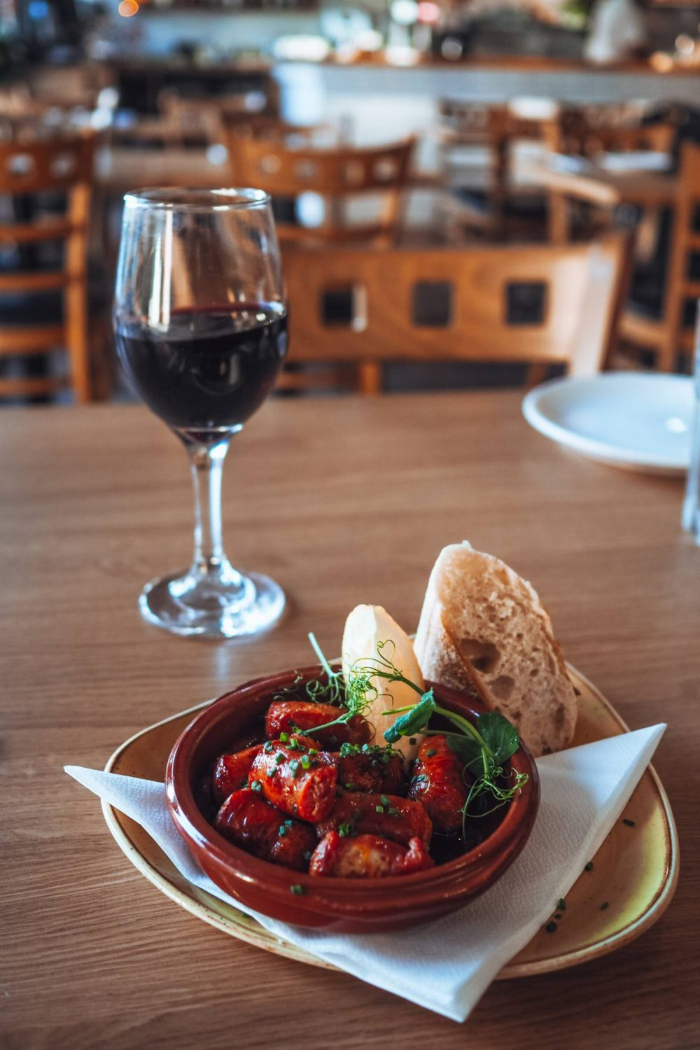 Chorizo and a glass of red wine at Olé Tapas Bar - Eat Out to Help out in Milton Keynes.