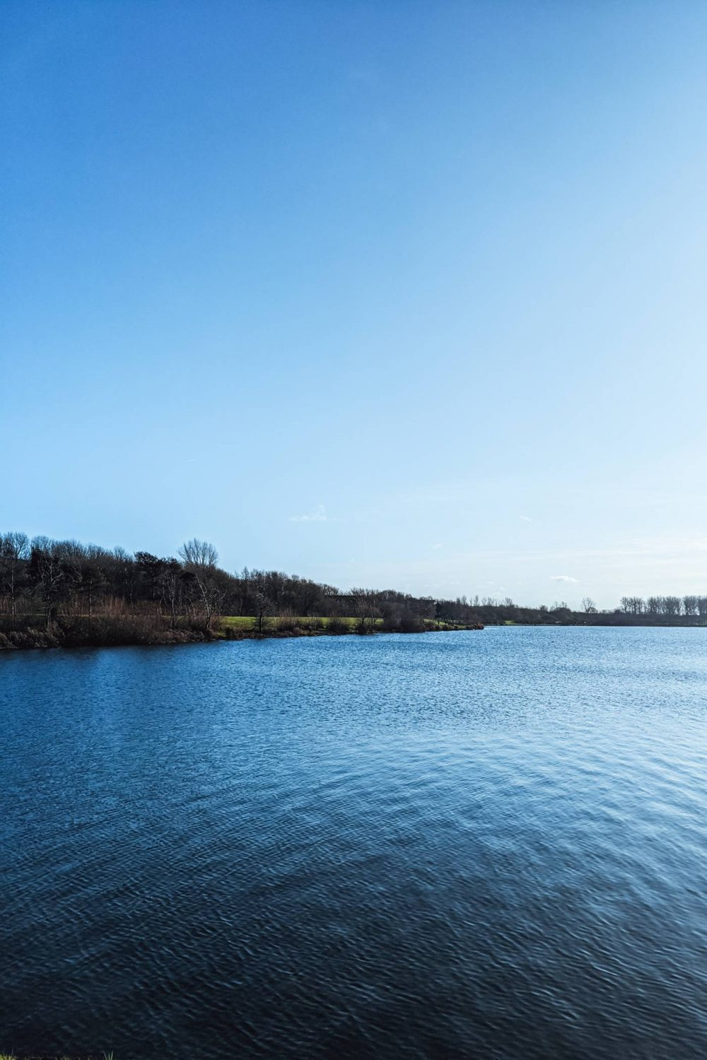 A photo of Willen Lake, Milton Keynes on a clear, sunny day