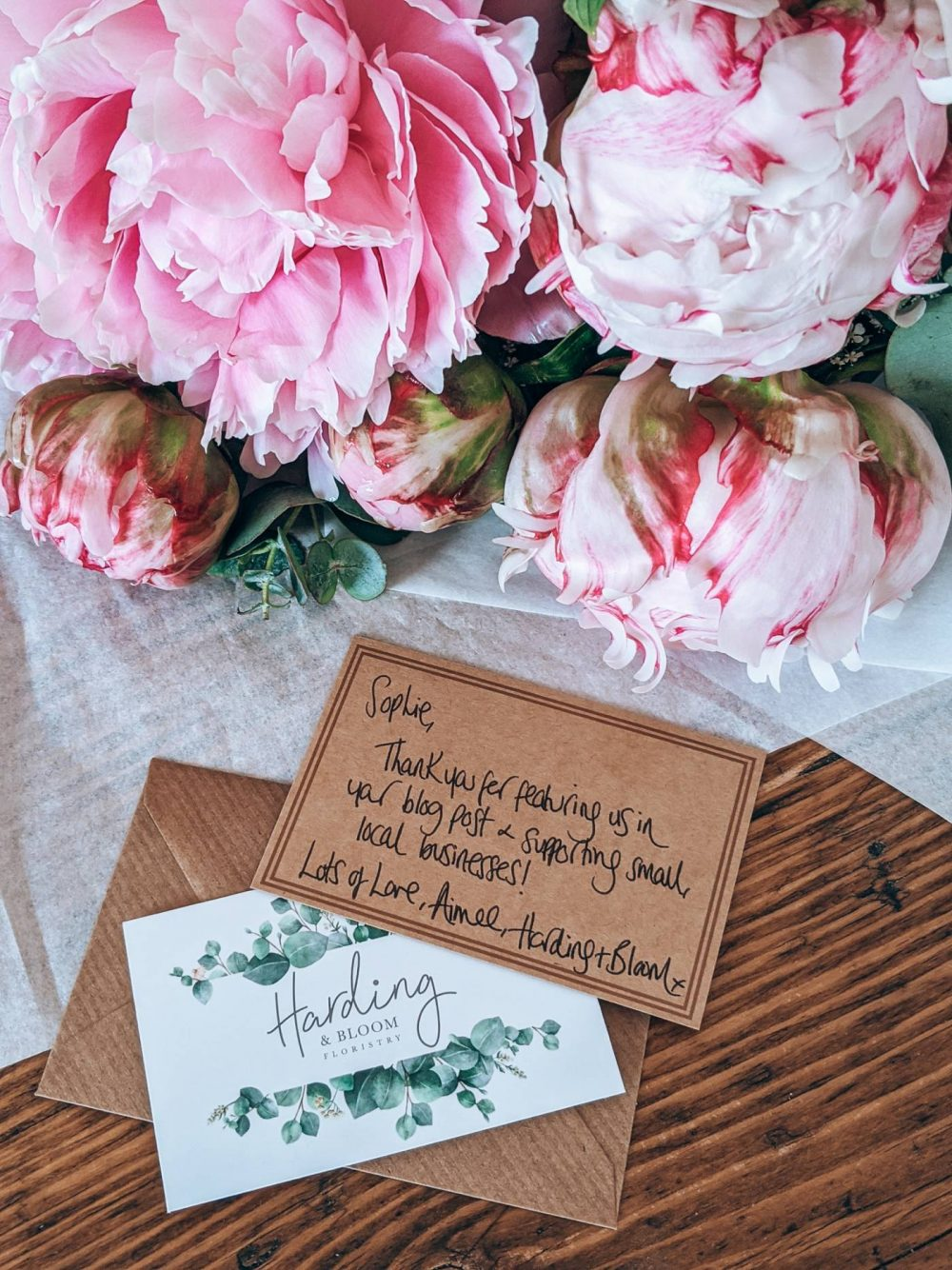 A photo of pink peonies from Harding in Bloom with a handwritten note that reads 'dear sophie, thank you for featuring us on your blog and supporting local business, love aimee, harding and bloom'