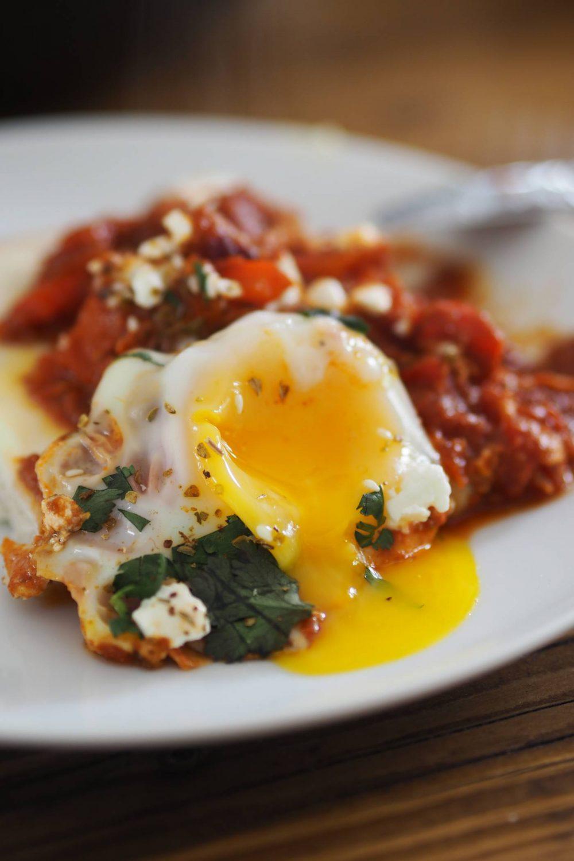 A runny egg yolk on a plate