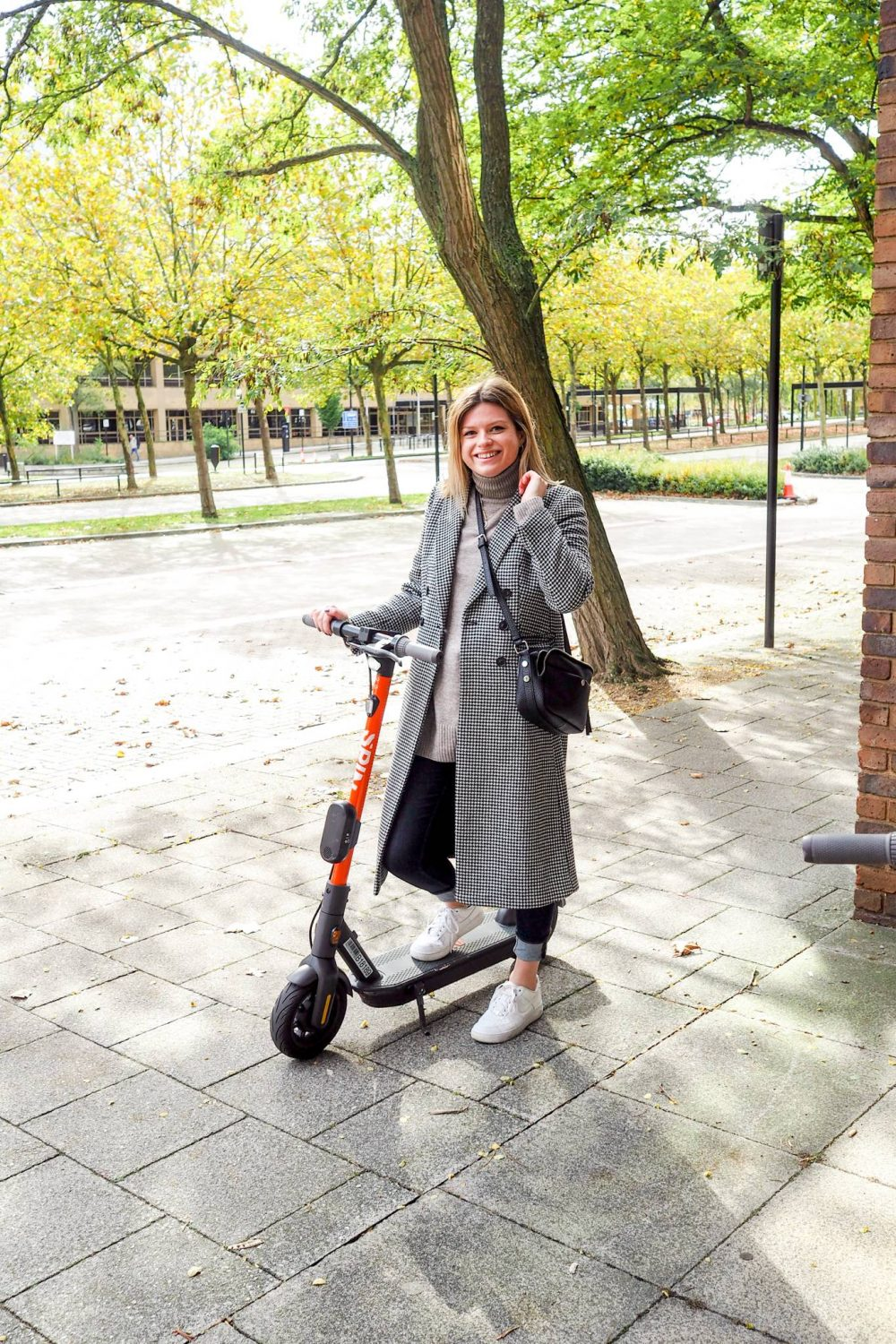 Sophie etc, Milton Keynes Blogger riding a Spin e-scooter.