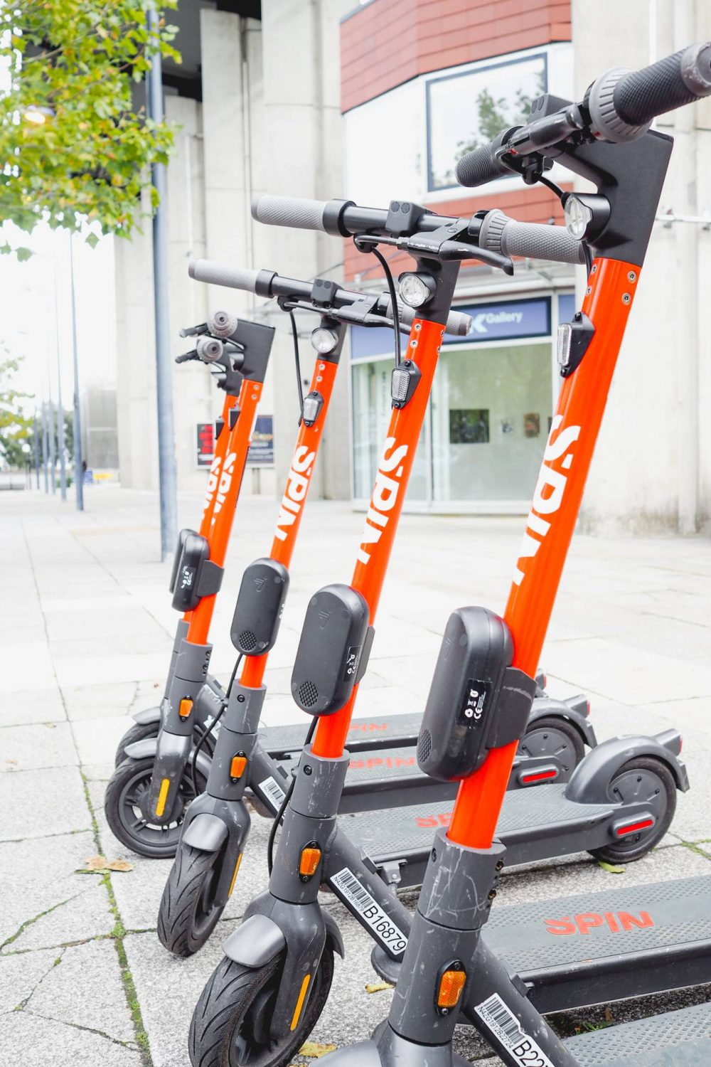 Five spin e-scooters parked in Central Milton Keynes.